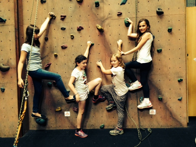 young carers on an indoor climbing wall